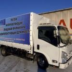 Реклама на тенте грузовика Isuzu Elf в Новосибирске